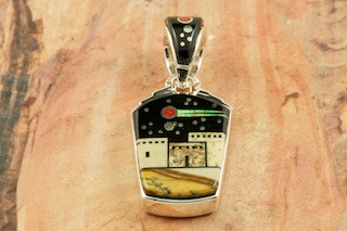 This Pendant is a work of art! Beautiful Starry Night in the Pueblo Design. Featuring Picture Jasper and Black Jade inlaid in Sterling Silver Pendant. Beautiful Fire and Ice Lab Opal Shooting Star! Reversible Pendant with Contemporary Sterling Silver Design. Free 18&quot; Sterling Silver Chain with Purchase of Pendant. Designed by Navajo Artist Calvin Begay. Signed by the artist.